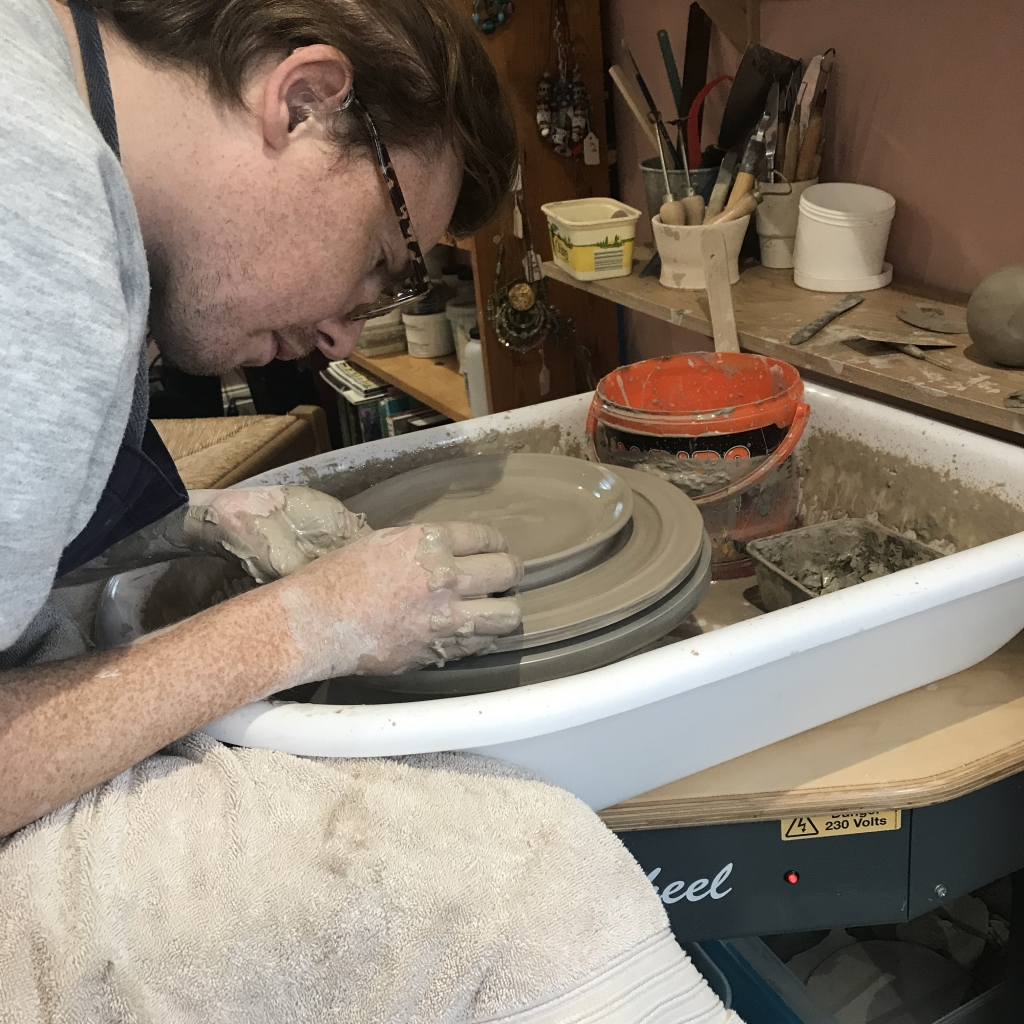 Pottery Student Throwing a Plate Sonya Ceramic Art Tuition