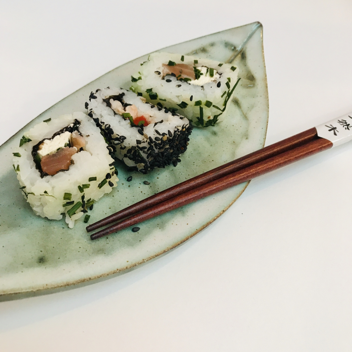 Leaf Sushi Dish with Chop Sticks and Sushi