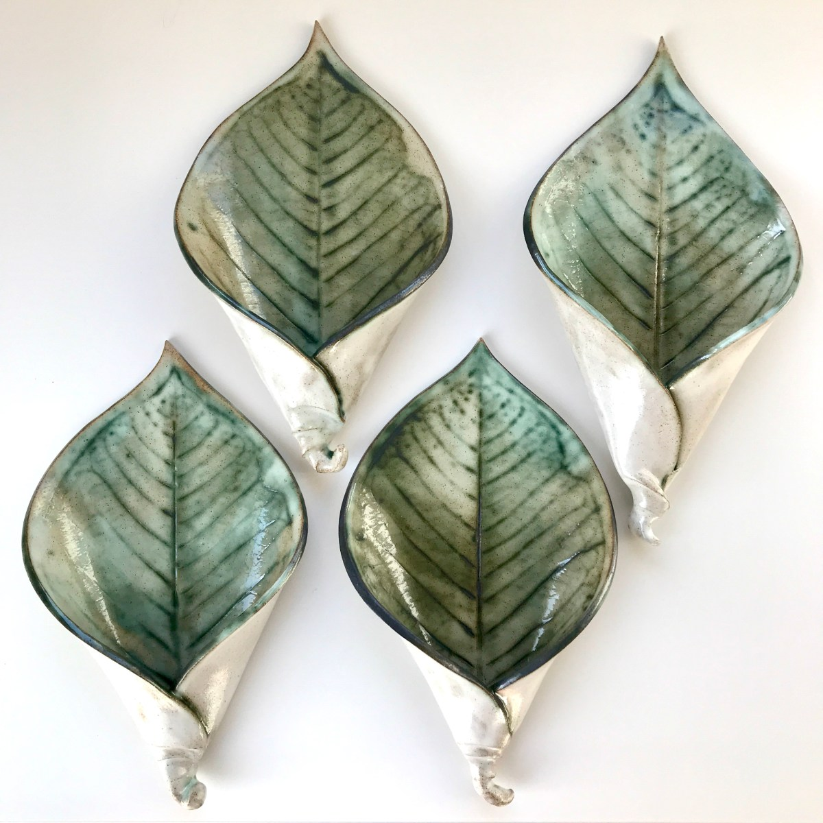 Lily Leaf Wall Planter by Sonya Ceramic Art (Group of 4 showing various shades of colour)