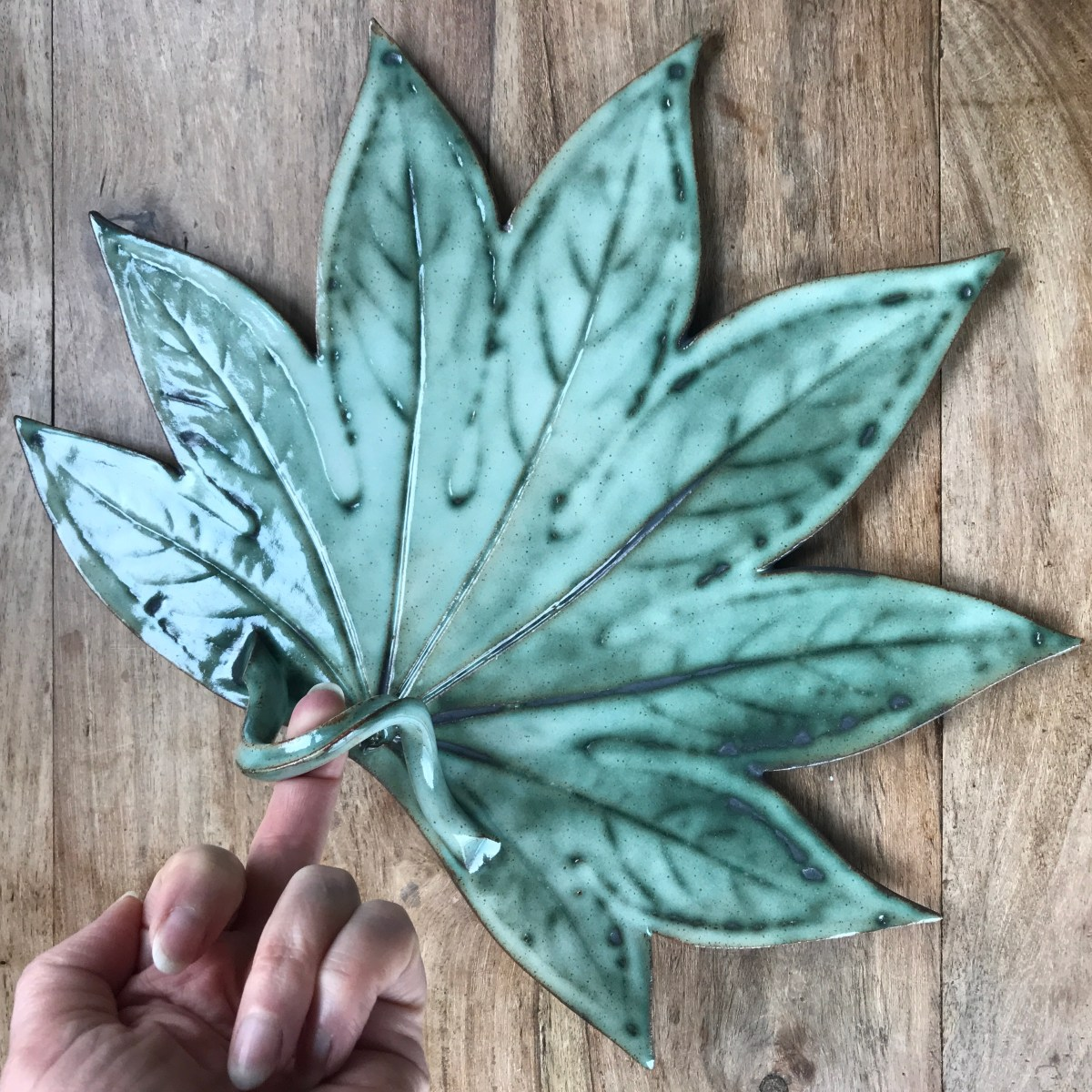 Fatsia Leaf Sharing Platter by Sonya Ceramic art - Ceramics Inspired by Nature (size context with hand)